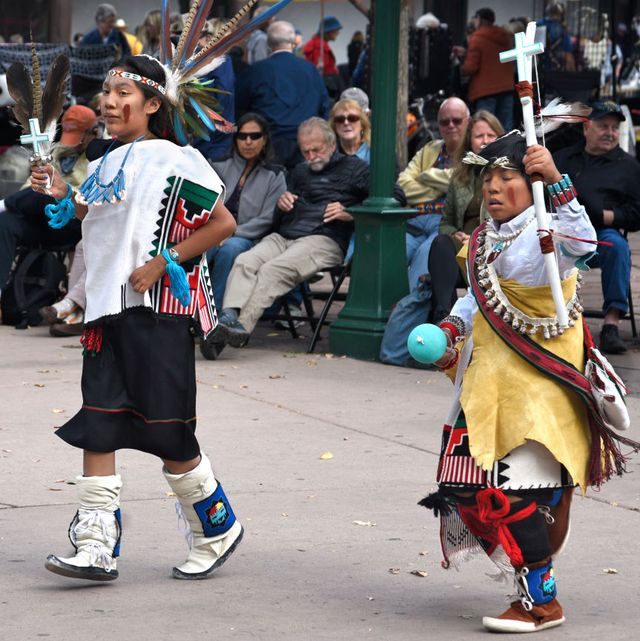 members of a dance troupe in new mexico participate in an indigenous peoples' day celebration