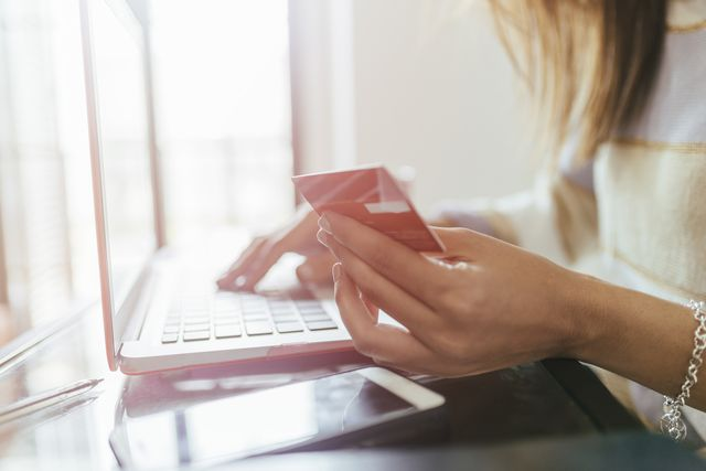 close up of woman buying from home on the laptop