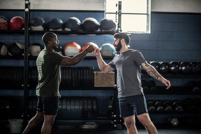 men fist bumping after cross training class