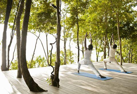 Men Practicing Yoga Outdoors