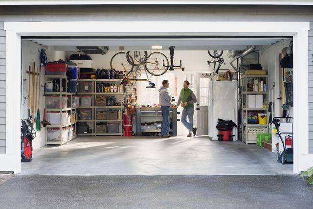 men talking in garage