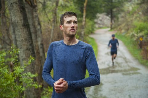 men trail run or rest to warm hands in boulder canyon, colorado