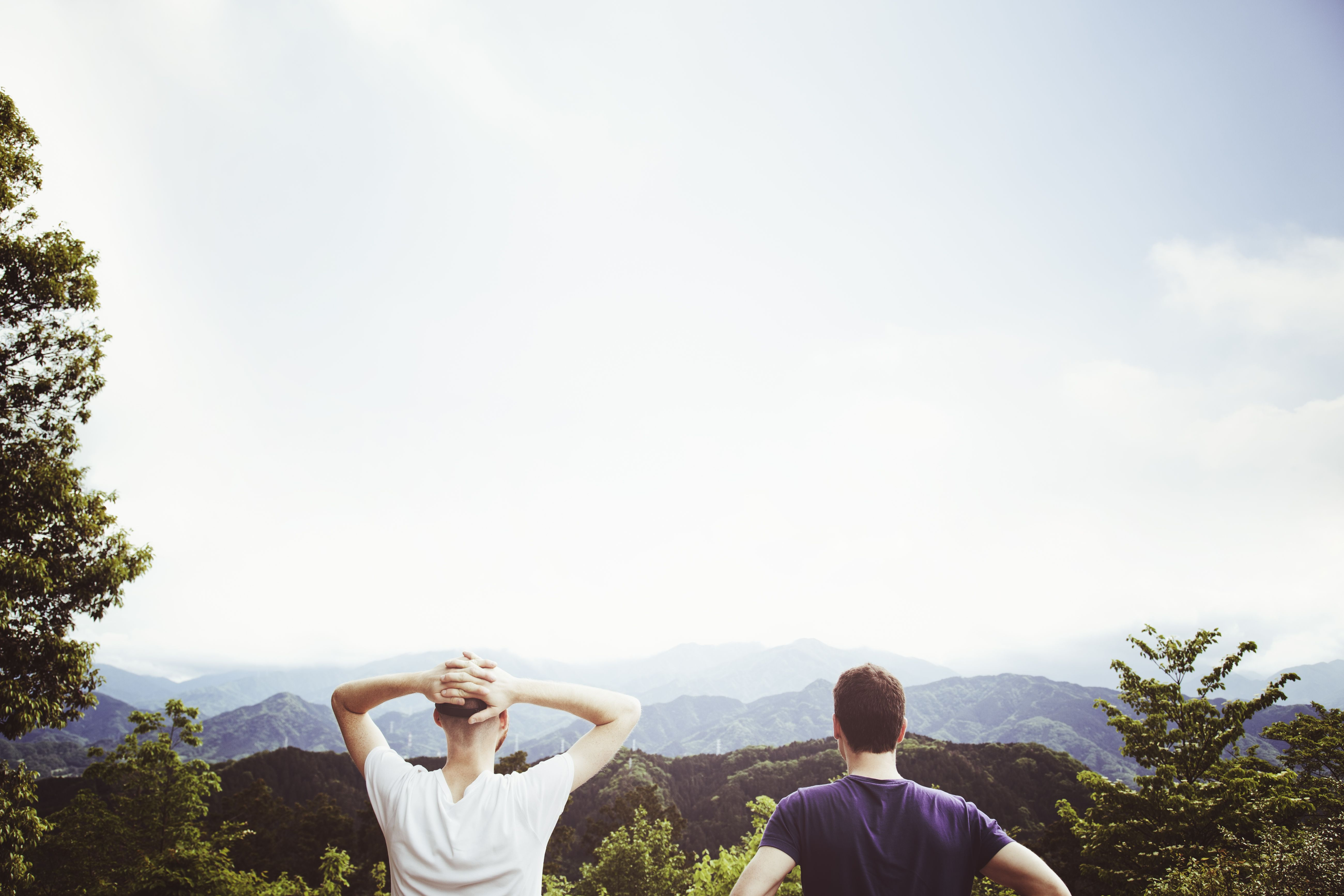 Men viewing the scenery from mountain