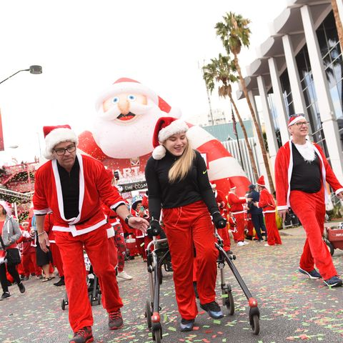 Red, Santa claus, Event, Tradition, Fictional character, Costume, Carnival, Musical ensemble, Christmas, Musician,
