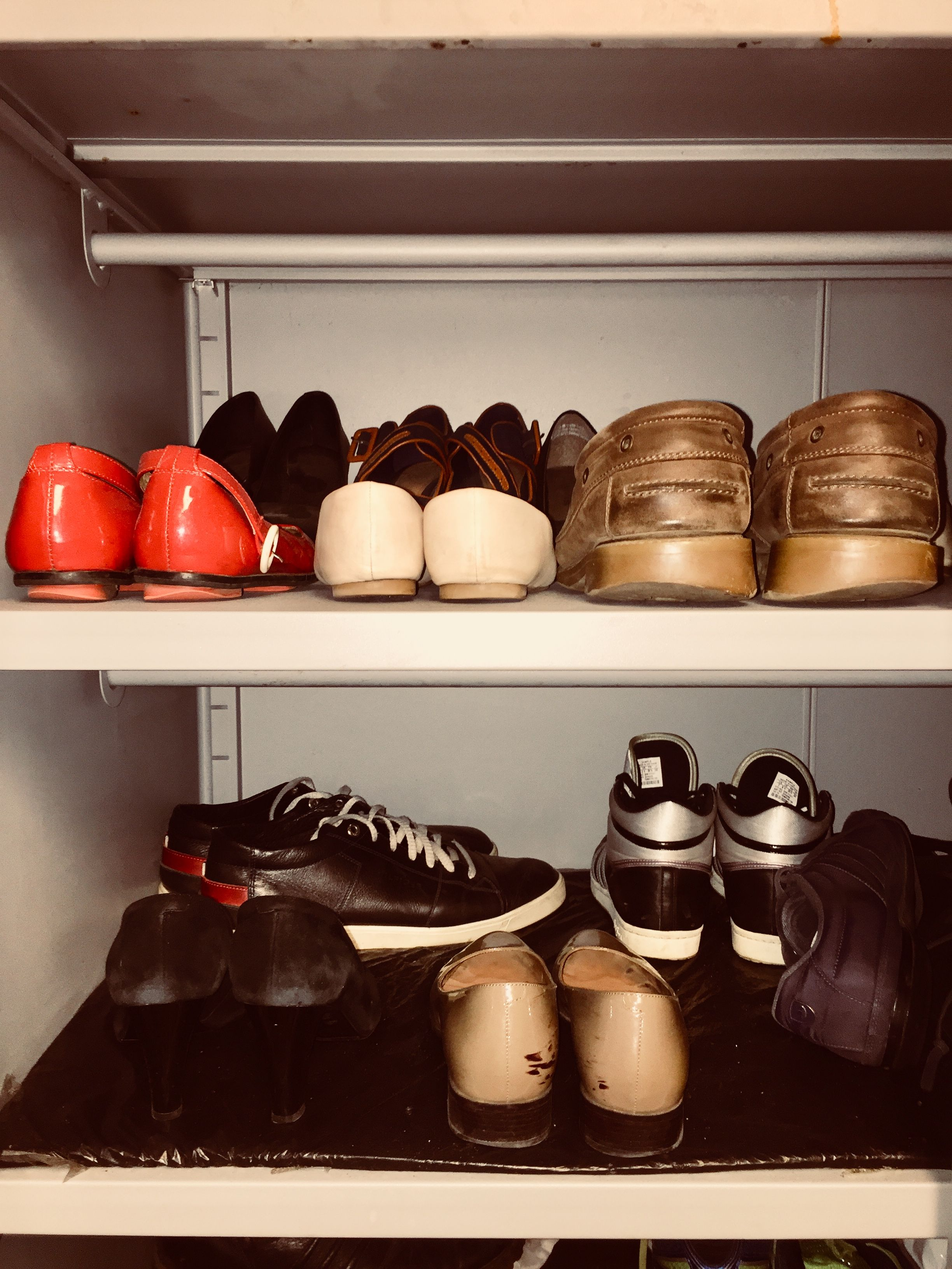 Men's and women's shoes in personal walk-in closet