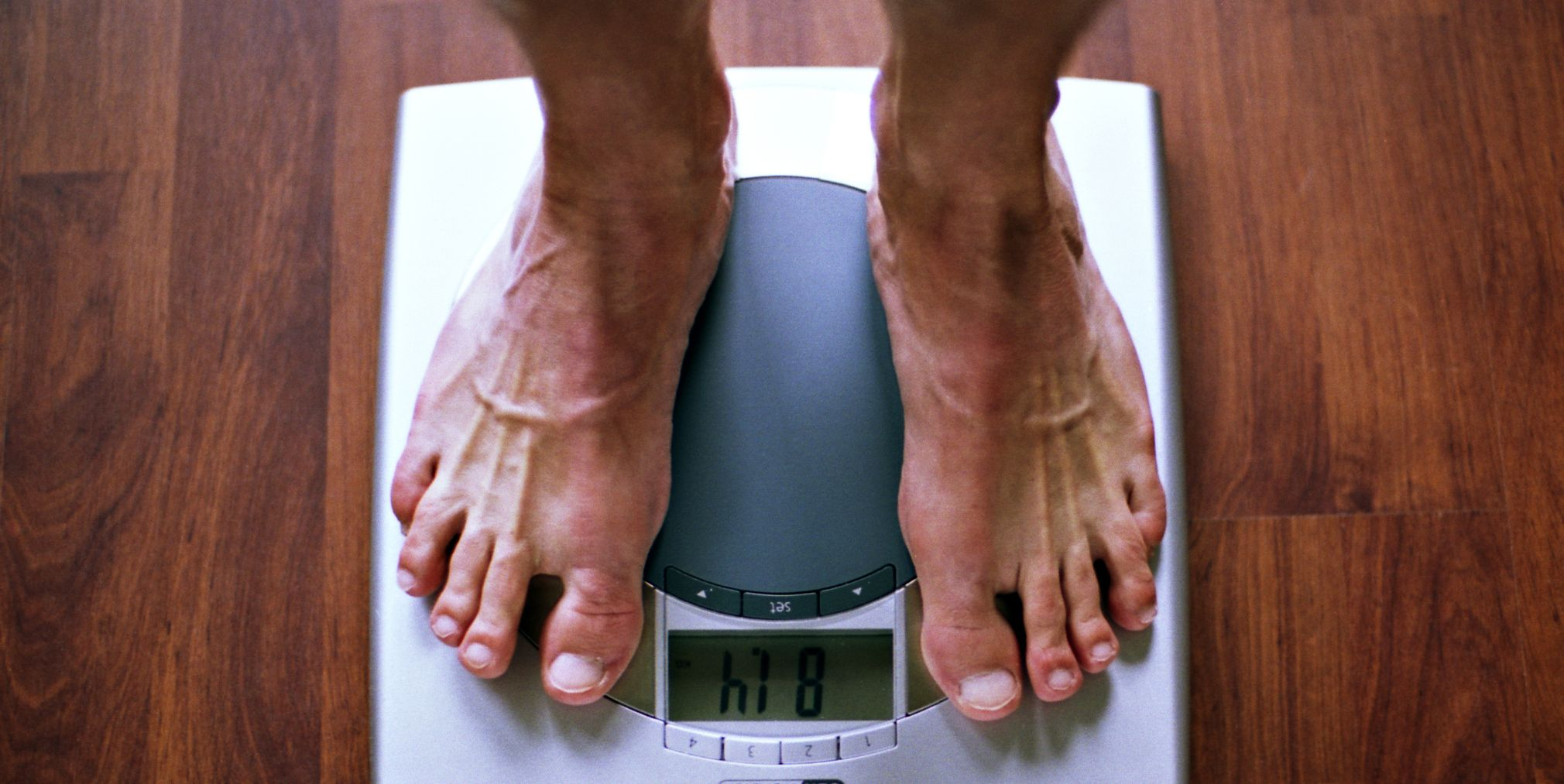 Men's feet on scale