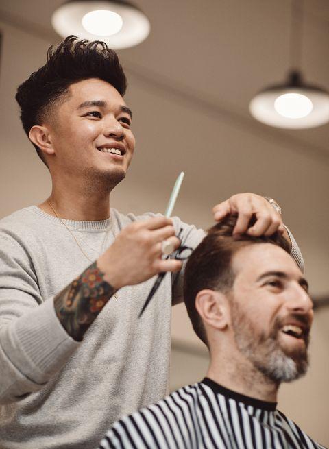 Hair, Hairstyle, Barber, Hairdresser, Makeup artist, Facial hair, Gesture, Ear, Hair care,