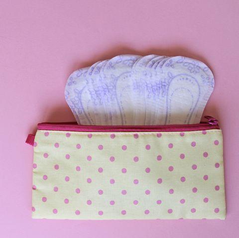menstrual bag with sanitary napkins on pink background