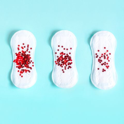 Menstrual pads with red glitter on colored background - menopause quiz