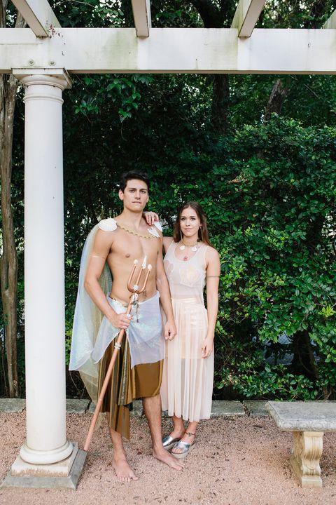 man and woman dressed as mermaid and merman