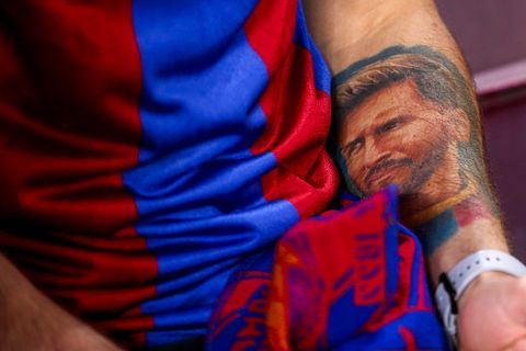 barcelona, spain   may 01 a fan of fc barcelona has a tattoo of lionel messi of fc barcelona on his arm during the uefa champions league semi final first leg match between barcelona and liverpool at the nou camp on may 1, 2019 in barcelona, spain photo by robbie jay barratt   amagetty images
