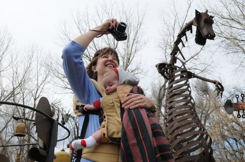 KL Metal sculptures were moved at the Swetsville Zoo on Monday, March 16, to make way for the widening of Harmony Road east of Interstate 25 by the Town of Timnath. Rebekah Walston, from Fort Collins, holds her son Joshua Walston, 5 months old, while she