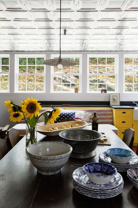 Yellow, Room, Blue, Interior design, Table, Furniture, Home, Porcelain, Architecture, Window,