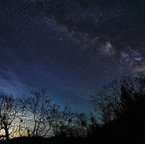 Meteor shower in night sky