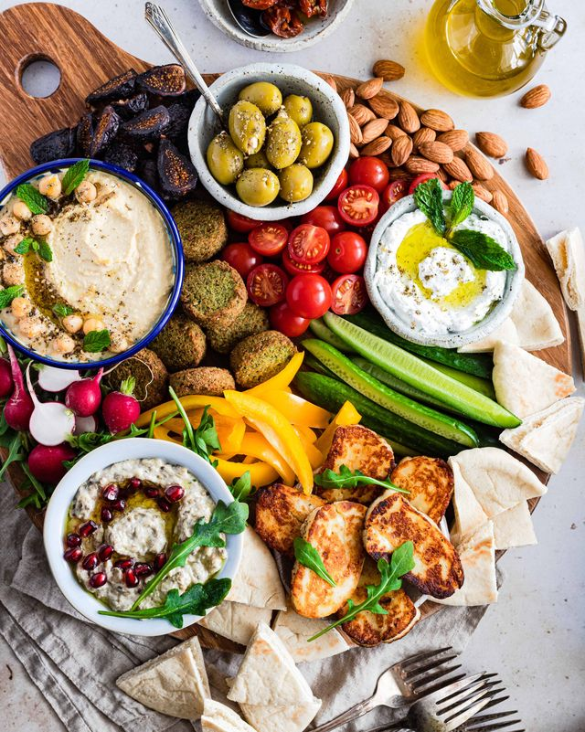 mezze platter with dips, cucumbers, tomatoes, falafel