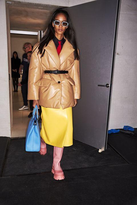 Clothing, Fashion, Eyewear, Yellow, Fashion model, Fashion show, Trench coat, Fashion design, Street fashion, Outerwear,
