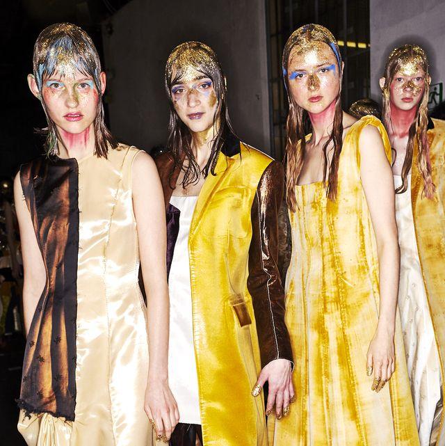 Yellow, Clothing, Fashion, Fashion design, Event, Fashion model, Dress, Costume, Outerwear, Costume design,