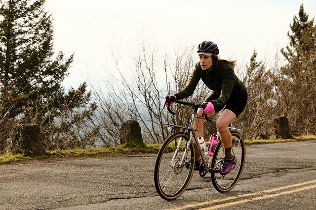 a female cyclist riding a road bike in the winter