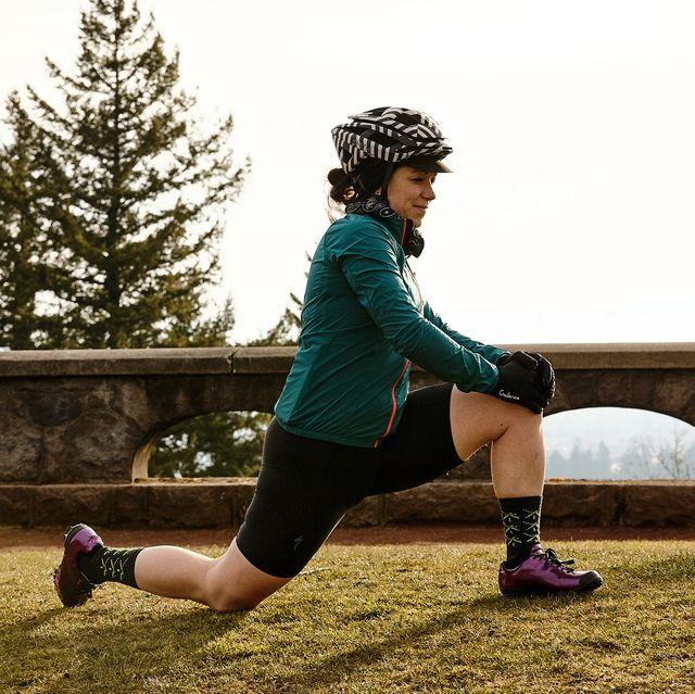 a female cyclist stretching