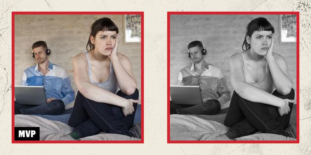 sad woman whose boyfriend is on a laptop