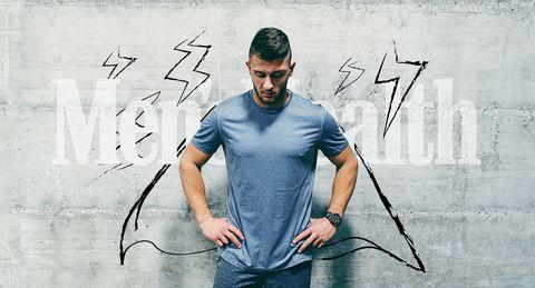 man met cape voor men's health logo