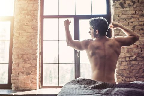 Barechested, Muscle, Arm, Shoulder, Window, Leg, Room, Sunlight, Photography, Interior design,