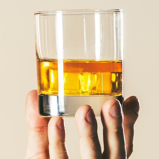 camarena reposado, a hand holding a glass of tequila, and casamigos resposado