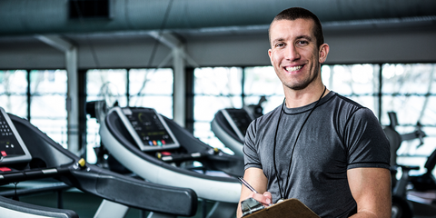 Male personal trainer at gym