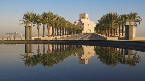 Reflection, Reflecting pool, Water, Landmark, Architecture, Tree, Palm tree, Sky, Building, Waterway,