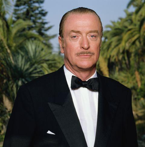 Suit, Formal wear, Tuxedo, Forehead, Tie, Bow tie, White-collar worker,