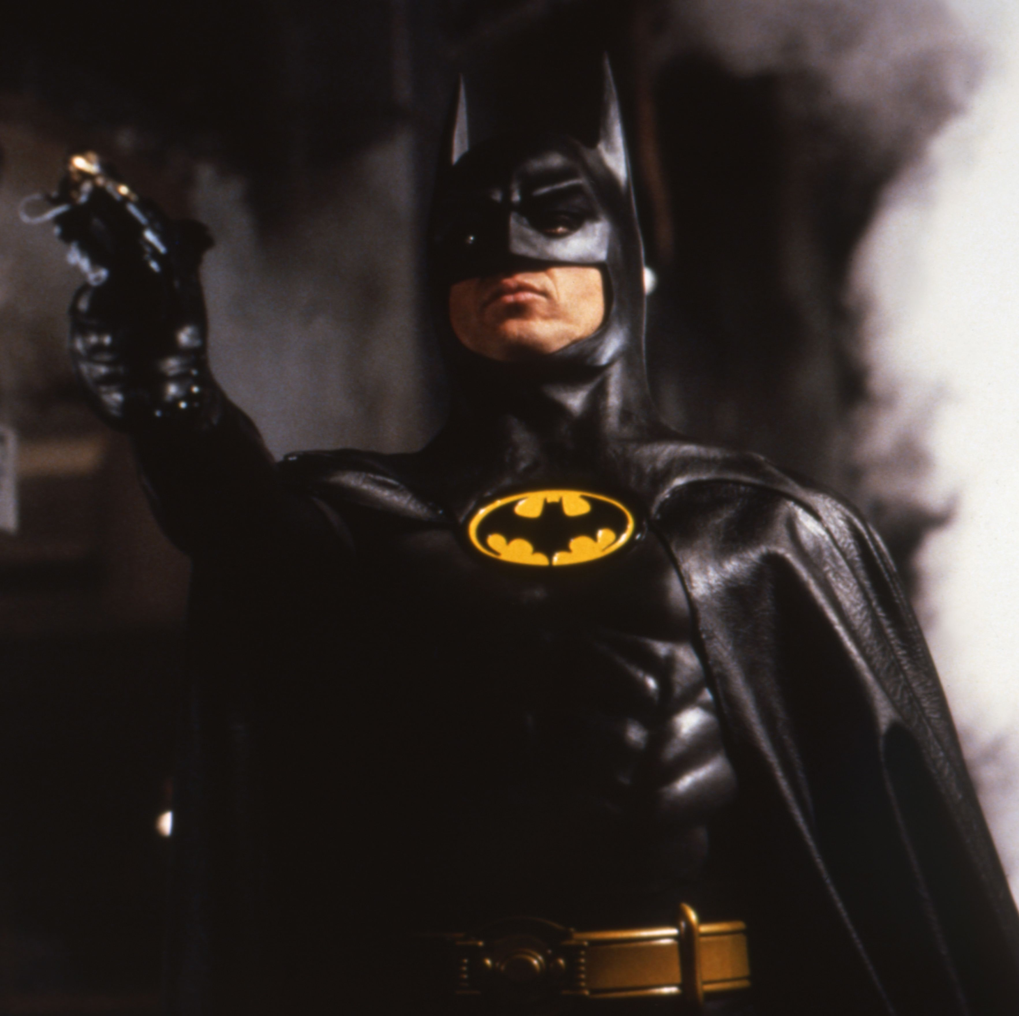 Michael Keaton as Batman in the 1989 Tim Burton film of the same name. Keaton dropped a line from the movie during his appearance on Saturday Night Live , where he played Julian Assange.