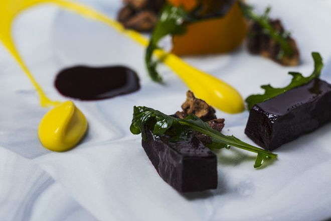 Magallanes uses a small amount of hash to complement his dishes, such as braised beets with roasted pumpkin, pumpkin purée, pecans, and arugula. Courtesy of Opulent Chef