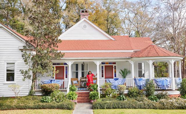 a woman on her farmhouse porch