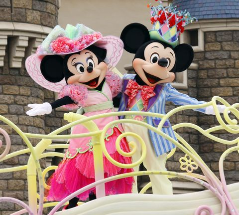 Mickey (R) and Minnie Mouse perform on a