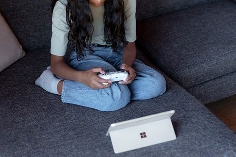 girl gaming with microsoft surface go 3