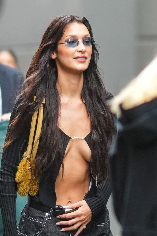 saint denis, france   june 30 bella hadid wears a black ribbed opened cardigan, a yellow fluffy bag, a fendi belt, during jacquemus la montagne show, at la cite du cinema on june 30, 2021 in saint denis, france photo by edward berthelotgetty images