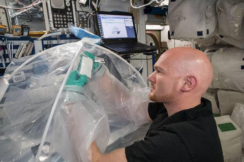 European Space Agency astronaut Alexander Gerst works on the MICS experiment aboard the International Space Station.