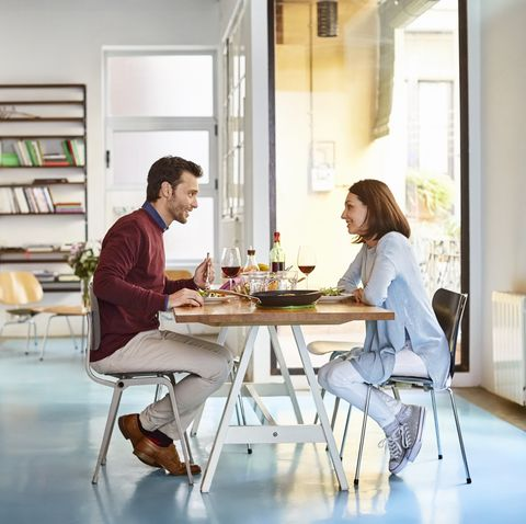 mid adult couple sitting at dining table