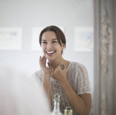 mid adult woman looking at herself in mirror