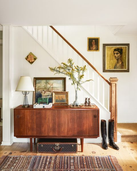 modern farmhouse entry with midcentury credenza