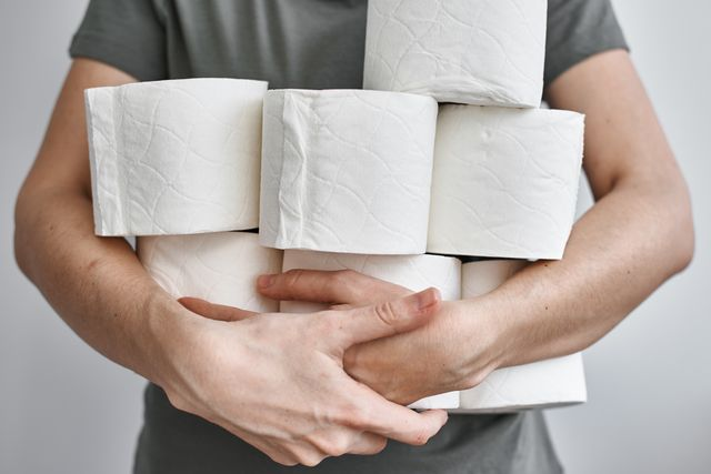 midsection of man holding toilet papers