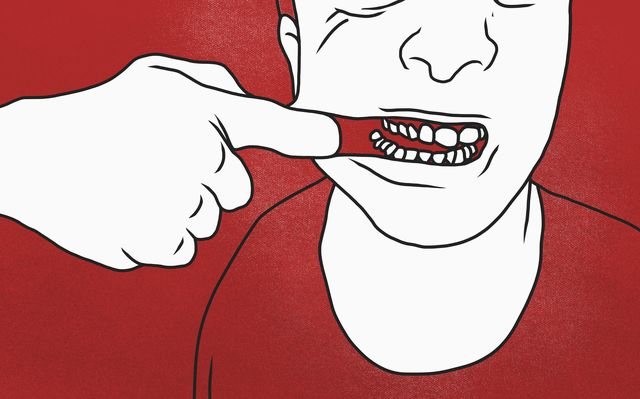 midsection of man pulling mouth against red background