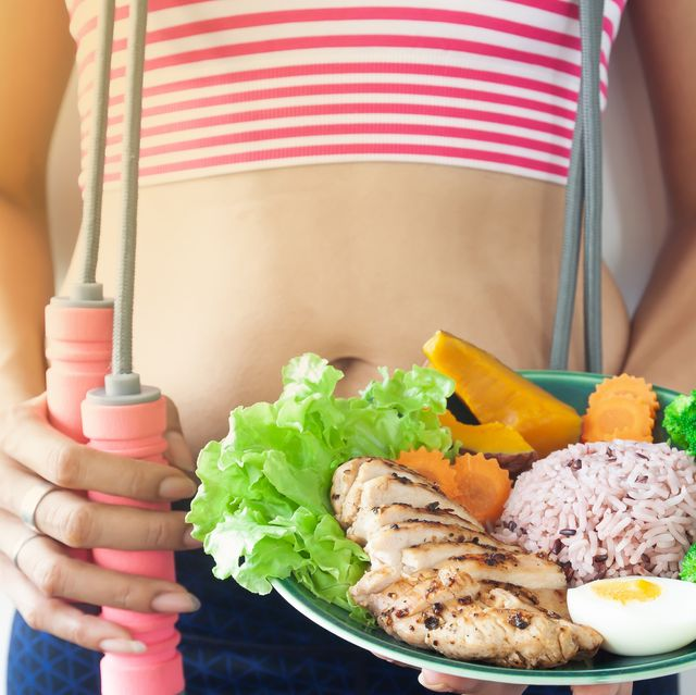 midsection of woman holding food in plate