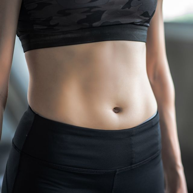 midsection of woman standing in gym