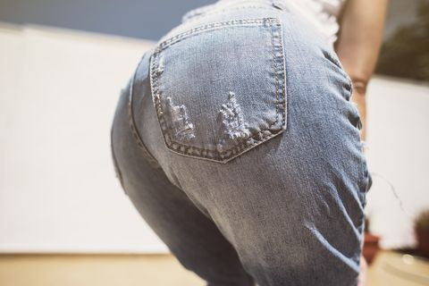 midsection of woman wearing jeans
