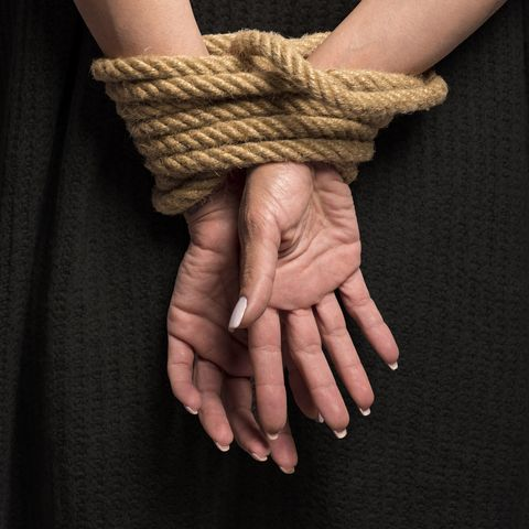 Midsection Of Woman With Tied Hands