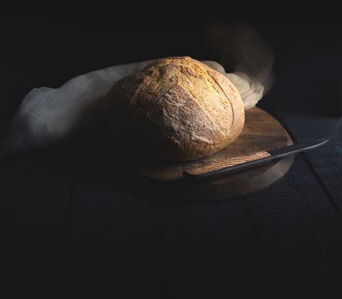 Still life photography, Light, Still life, Bread, Photography, Darkness, Rock, Stock photography, Space, Shadow,