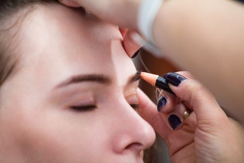 mikrobleyding eyebrows workflow in a beauty salon selective focus and shallow depth of field