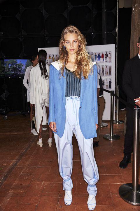 Clothing, Fashion, Denim, Outerwear, Jeans, Street fashion, Performance, Footwear, Event, Fashion design,