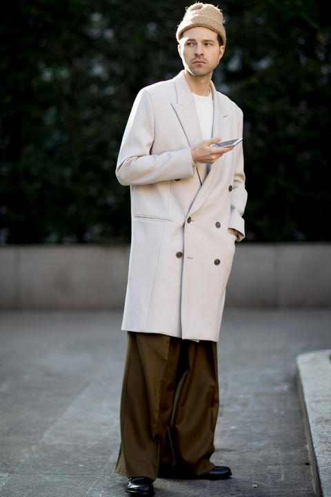 Clothing, Fashion, Uniform, Outerwear, Trench coat, Coat, Suit, Headgear, Overcoat, Street fashion,